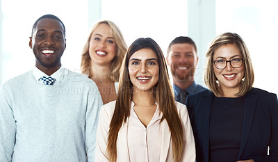 Buy stock photo Portrait of a group of confident work colleagues standing together against a white background