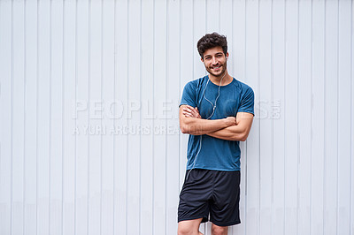 Buy stock photo Portrait of a sporty young man standing against a white wall