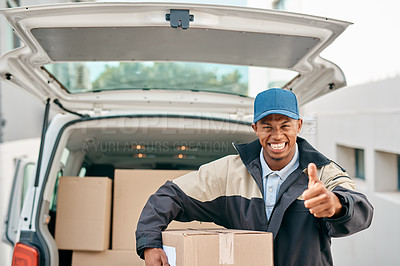 Buy stock photo Portrait of a courier showing thumbs up while unloading boxes from a delivery van
