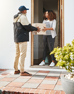 Buy stock photo Shot of a courier making a delivery to a customer at her home