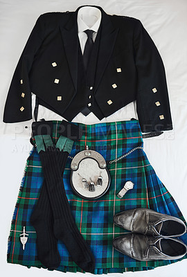 Buy stock photo Shot of a traditional Scottish formal suit resting against a white background