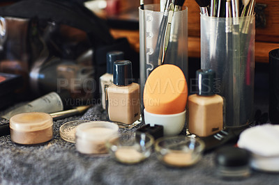Buy stock photo Shot of a numerous amount of different types of makeup laid out on top of a table