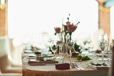 Buy stock photo Shot of a nicely set table with cutlery and crockery placed together inside of a building during the day