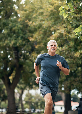 Buy stock photo Shot of a senior man out for a run in the park