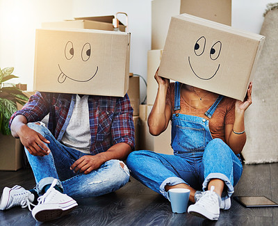 Buy stock photo Shot of an unrecognizable couple moving house
