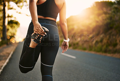 Buy stock photo Shot of a young woman out for her morning run