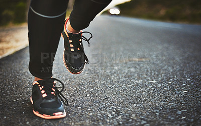 Buy stock photo Cropped shot of an unrecognizable woman wearing comfortable running shoes