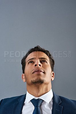 Buy stock photo Studio shot of a corporate businessman posing against a grey background