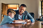 Dad helps him everyday to get his homework done