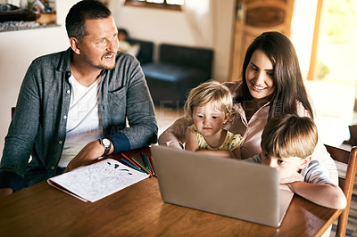 Buy stock photo Shot of an adorable brother and sister using a laptop with their mother at home
