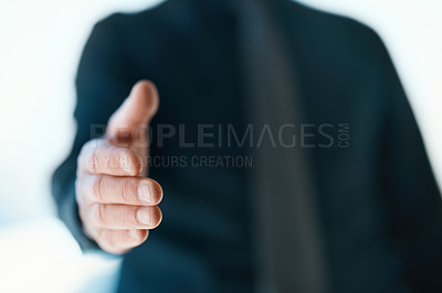 Buy stock photo Cropped shot of an unrecognizable businessman reaching out for a handshake