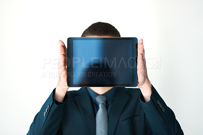 Buy stock photo Cropped shot of an unrecognizable businessman holding a digital tablet up in front of his face