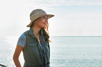 Buy stock photo Shot of an attractive young woman enjoying a walk by the lake