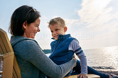 Buy stock photo Shot of a beautiful young mother and her son enjoying a day at the lake