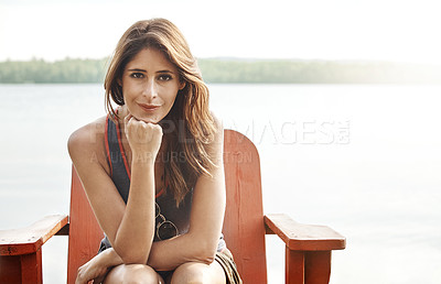Buy stock photo Portrait of an attractive young woman relaxing at the lake