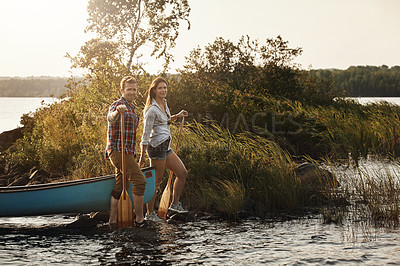 Buy stock photo Portrait of a young couple going for a canoe ride on the lake