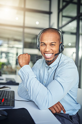 Buy stock photo Cropped shot of a young handsome male customer support agent working in the office