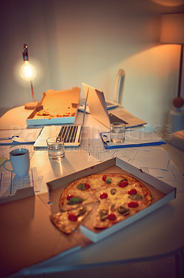 Buy stock photo Still life shot of pizza on a desk in an office