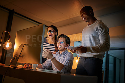 Buy stock photo Shot of computer programmers working together late in the office