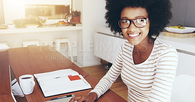Buy stock photo Portrait of a cheerful young woman typing and working on a laptop while drinking coffee at home