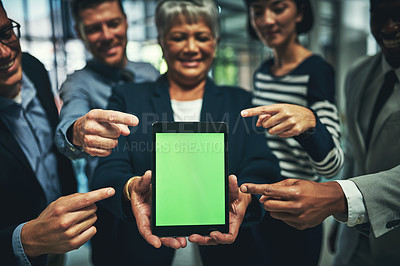 Buy stock photo Shot of a group of businesspeople pointing to a digital tablet with a chroma key screen