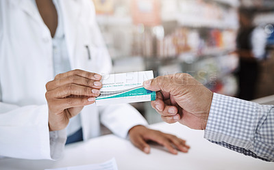 Buy stock photo Cropped shot of an unrecognizable young female pharmacist helping a customer in a pharmacy