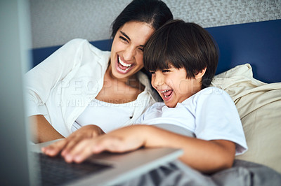 Buy stock photo Shot of a mother and her little son using a laptop together at home