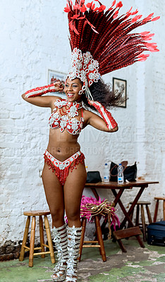 Buy stock photo Cropped shot of a beautiful samba dancer getting ready for a performance during carnival