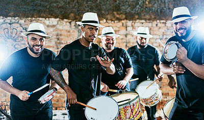 Buy stock photo Cropped shot of a group of men drummers playing music outside