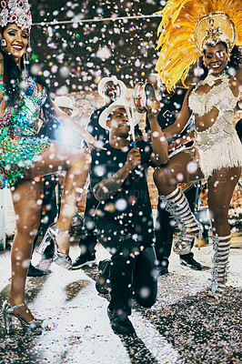 Buy stock photo Shot of beautiful samba dancers performing in a carnival with their band