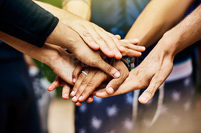 Buy stock photo Shot of a group of unrecognizable people's hands forming a huddle together outside during the day