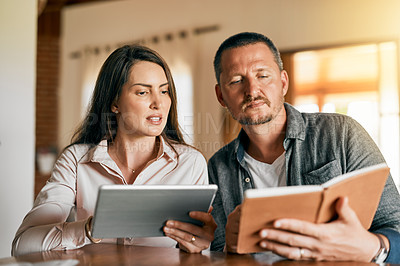 Buy stock photo Cropped shot of a married couple planning their financial budget at home