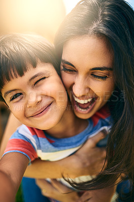 Buy stock photo Closeup portrait of an attractive young woman and her young son outside