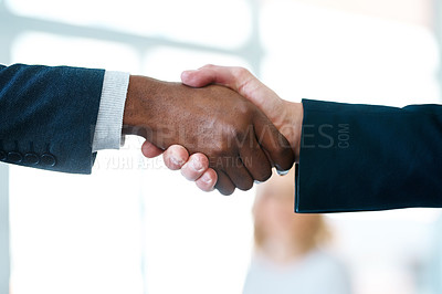 Buy stock photo Closeup shot of two unrecognizable businessmen shaking hands in an office