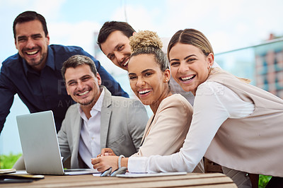 Buy stock photo Cropped portrait of a group of businesspeople gathered around a laptop during a meeting in the boardroom