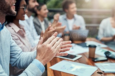 Buy stock photo Shot of a group of colleagues applauding during a meeting at a cafe