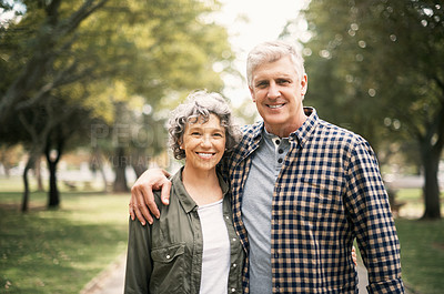 Buy stock photo Portrait of a senior couple spending the day in the park