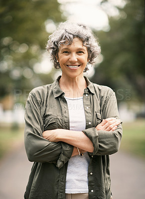 Buy stock photo Portrait of a confident senior woman spending the day in the park