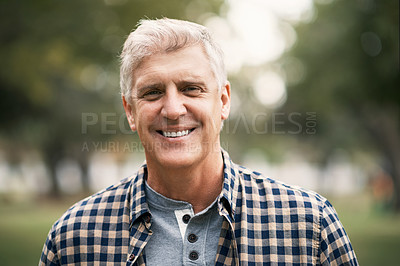 Buy stock photo Portrait of a happy senior man spending the day in the park