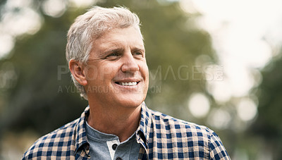 Buy stock photo Shot of a happy senior man spending the day in the park