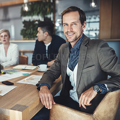 Buy stock photo Portrait of a mature businessman sitting in a meeting in an office