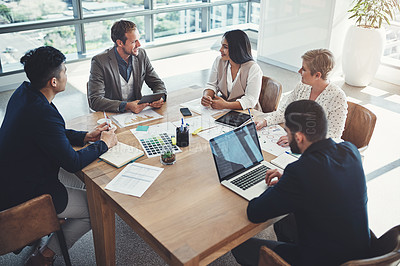 Buy stock photo Shot of a diverse group of businesspeople having a meeting in an office