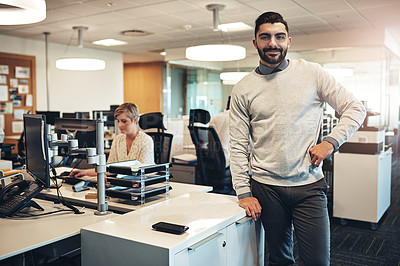 Buy stock photo Portrait of a businessman in the office while his colleagues are working in the background