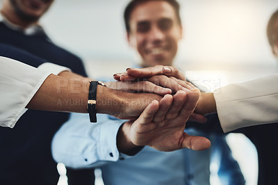 Buy stock photo Closeup shot of an unrecognizable group of businesspeople joining their hands together in a huddle
