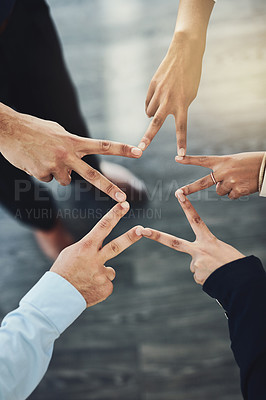 Buy stock photo Closeup shot of an unrecognizable group of businesspeople joining their fingers together in an office