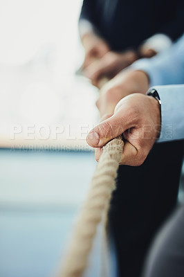 Buy stock photo Closeup shot of unrecognizable businesspeople pulling on a rope