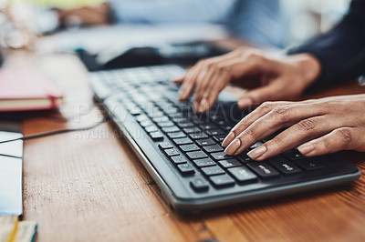 Buy stock photo Closeup shot of an unrecognizable businesswoman typing on a keyboard in an office