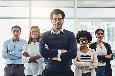 Buy stock photo Portrait of a group of businesspeople standing with their arms crossed in an office