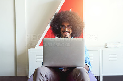 Buy stock photo Cropped shot of a young creative employee using a laptop in a modern office
