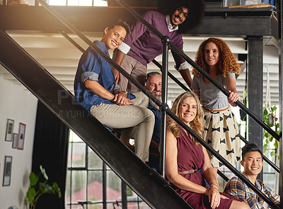 Buy stock photo Portrait of a group of diverse creative employees sitting on steps in a modern office